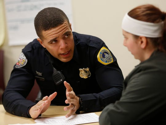 Senior officer Jared Underwood with the Des Moines Police Department talks with prospective recruits Thursday, March 30, 2017, during a meet and greet recruiting event hosted by the NAACP at the Evelyn Davis Center for Working Families in Des Moines.