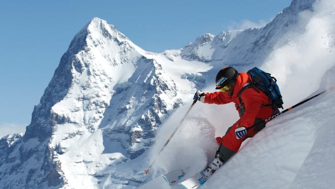 """A skier rides down fresh powder in Switzerland for the Warren Miller film, """"Ticket to Ride."""""""