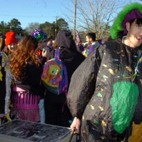 Doing the Mardi Gras Mambo at the Eunice Courir de Mardi Gras. See more photos at dailyworld.com and on Facebook.