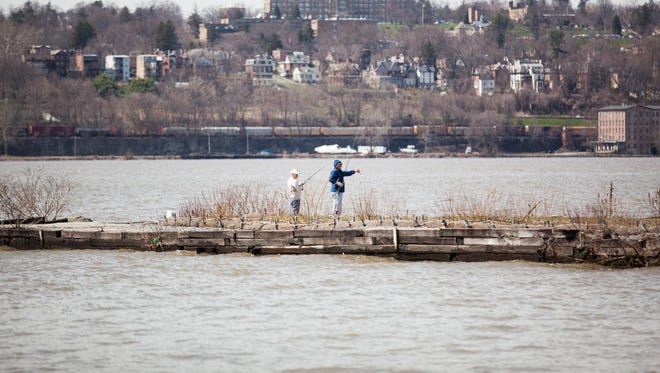 Fishermen cast lines into the Hudson River at Long Dock Park in Beacon on April 10.
