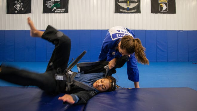 Brinna Lavelle throws Bowen at Bowen Combative Arts Academy in Clarksville. The judo portion of the FISU America Games are July 22-25.