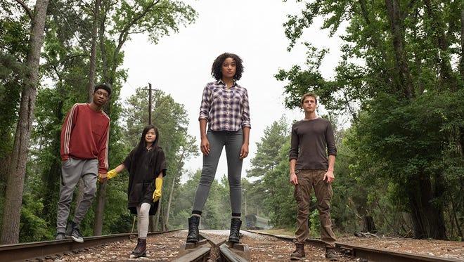 "Skylan Brooks, Miya Cech, Amandla Stenberg and Harris Dickinson in ""The Darkest Minds."""
