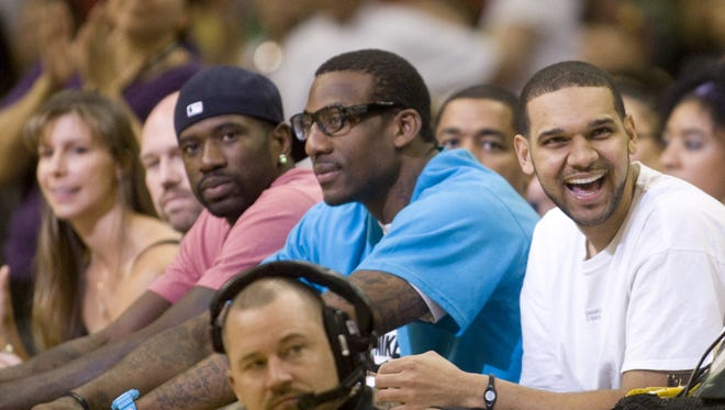 Phoenix Suns players Jason Richardson,  Amar'e Stoudemire and Jared Dudley at a Phoenix Mercury game in 2010.