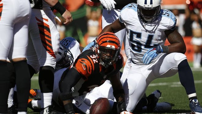 Cincinnati Bengals running back Jeremy Hill (32) looks up for the call after his fourth quarter touchdown against the Tennessee Titans at Paul Brown Stadium.