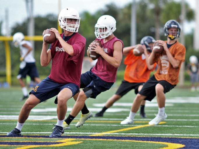 Naples quarterbacks run drills during the Golden Eagle's first practice of the season.