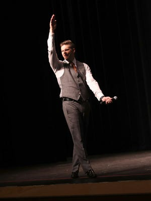 """White nationalist Richard Spencer, who popularized the term """"alt-right"""" speaks at the Curtis M. Phillips Center for the Performing Arts on October 19, 2017 in Gainesville, Florida. Spencer delivered a speech on the college campus his first since he and others participated in the """"Unite the Right"""" rally which turned violent in Charlottesville, Virginia."""