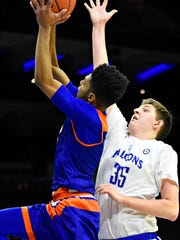 York High's Kyree Generett, left, takes the ball to the basket while Cedar Crest defends during Court of Dreams game action at Wells Fargo Center in Philadelphia, Friday, Dec. 15, 2017. York High would win the game 55-48. Dawn J. Sagert photo