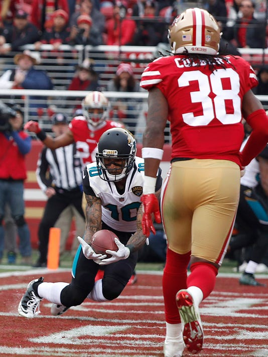 Jacksonville Jaguars wide receiver Jaelen Strong (10) scores a touchdown against the San Francisco 49ers during the first half of an NFL football game in Santa Clara, Calif., Sunday, Dec. 24, 2017. (AP Photo/Tony Avelar)