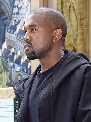 Kanye West leaves the Royal Geographical Society in central London on Saturday May 21, 2016.