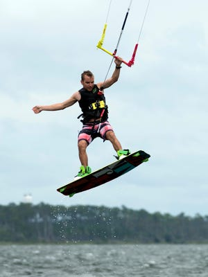 Garrett Benton takes advantage of the high winds begin kicked up by subtropical storm Alberto and get a little kite surfing in at Pensacola Beach, Fl, Monday, May 28, 2018.