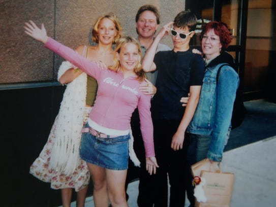 Sophie Shesto (second left) is seen in a family photo with (from left) sister Hanna, father Jeff, brother Max, and mother Susan while in downtown Milwaukee around 2004. Sophie died of a heroin overdose on June 28, 2015, at their home in Milwaukee.