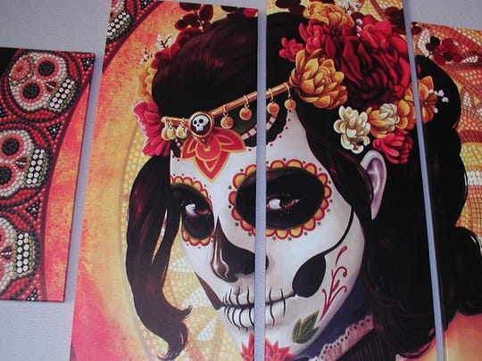The Catrina figure holds a cherished spot in Mexican tradition as an elegant lady of the dead.
