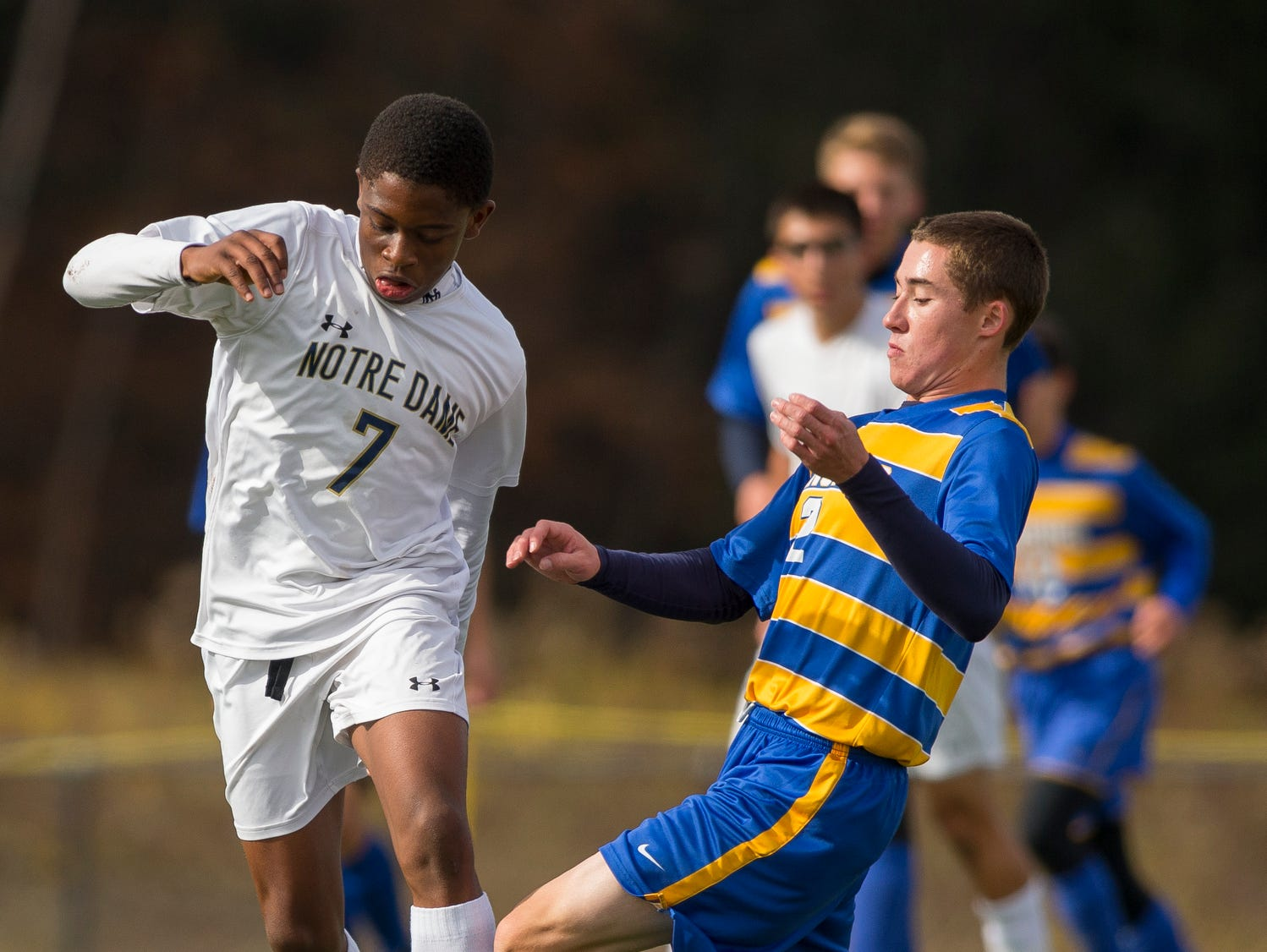 Notre Dame's Rocco Coulibaly, works the ball around Lansing's Ben Kutler Saturday afternoon during Notre Dame's win in the Section IV Class C soccer tournament.7 and 2