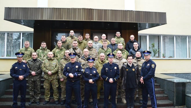The first graduating class of Ukrainian police officers with their trainers from the Reno Police Department.