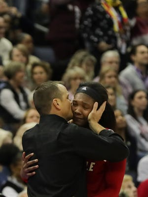 Louisville senior Myhisa Hines-Allen is comforted by Jeff Walz as she comes off the court. Louisville lost to Mississippi State in the Final Four. March 30, 2018