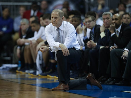 John Beilein on the bench during Michigan's 69-68 loss