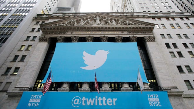 Twitter signage is draped on the facade of the New York Stock Exchange on  Nov. 7, 2013, in New York, the day Twitter shares began trading publicly.