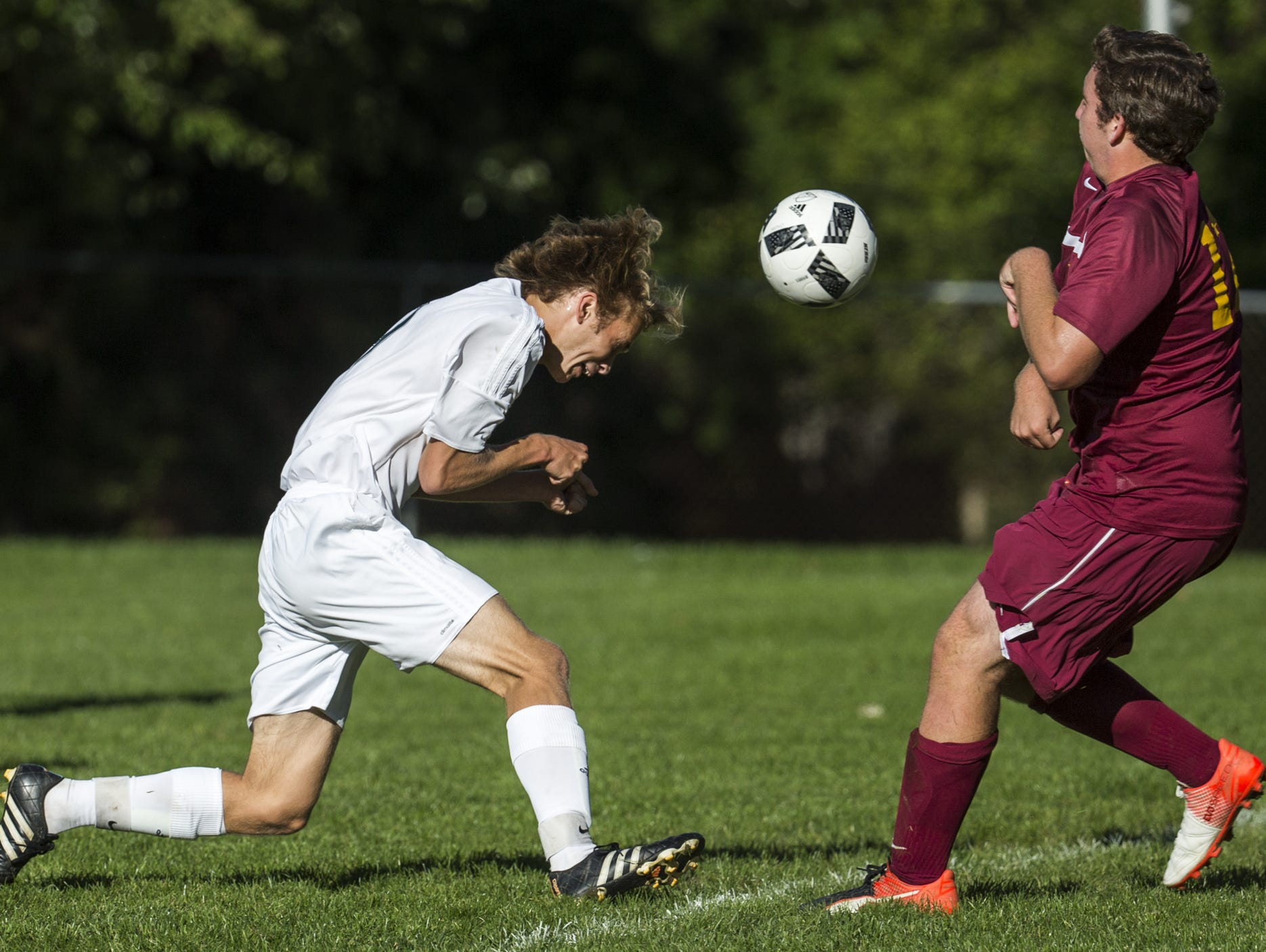 Archmere's Zachary Dainton (left) heads the ball past St. Elizabeth's Robert Miller during a 4-0 victory last Tuesday. The Auks won twice last week to move to No. 4 in The News Journal's Division II boys soccer rankings.