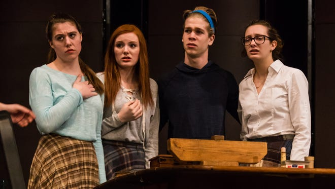 "The Frank family in a scene from Milford High School's production of ""The Diary of Anne Frank."""