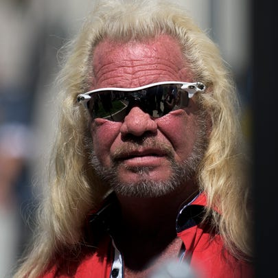Duane 'Dog the Bounty Hunter' Chapman stands by during