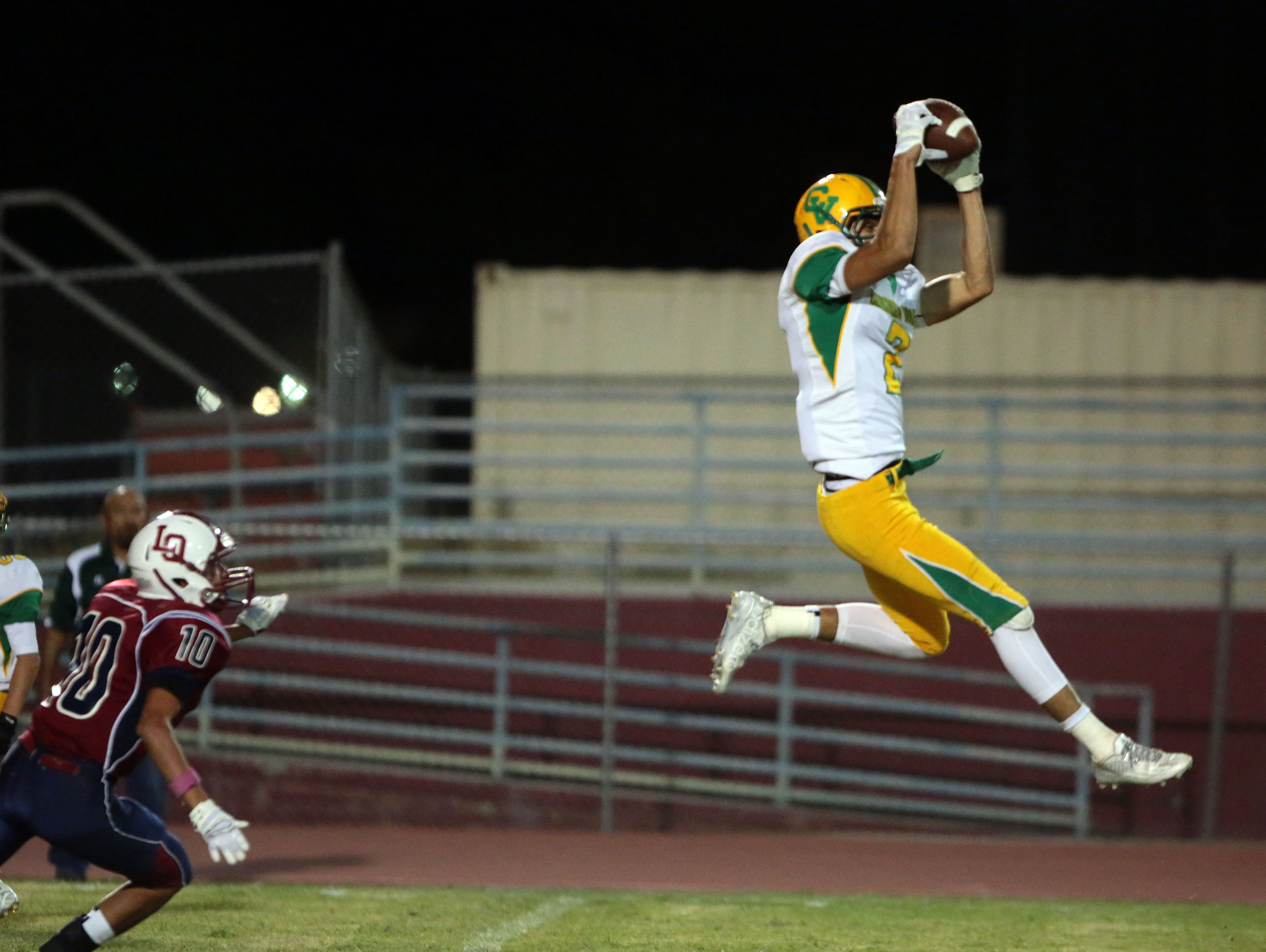 Coachella Valley's Marvin Martinez completes a pass fora first down against La Quinta in the first quarter on Friday in La Quinta.