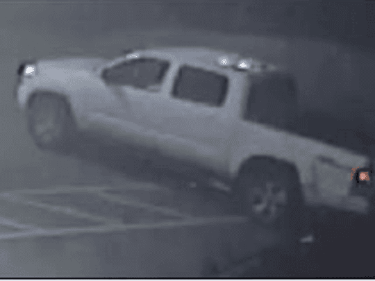 The suspect was seen driving a white Toyota truck, pictured here on surveillance video.