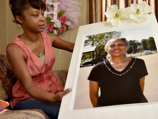 Angela Harrion holds a photo of her mother, Helen Harrion, at her home in Jackson in this 2015 file photo.