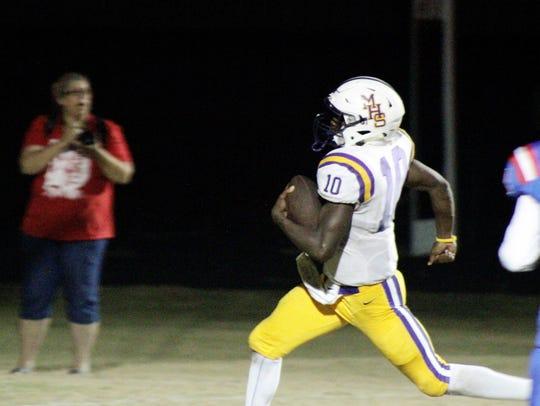 Marksville quarterback Daniel Miller (10) runs for