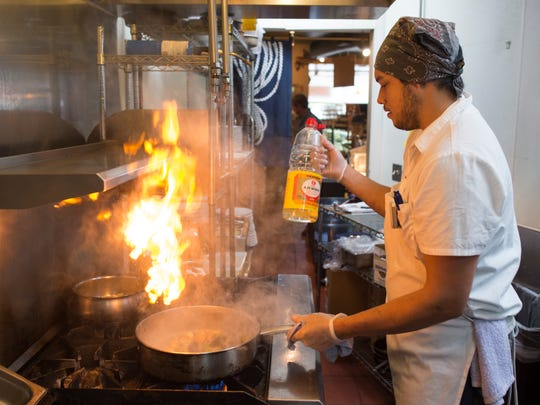 Chef Ryan Damasky prepares coconut mussels at Fish in Old Town Fort Collins on Thursday.