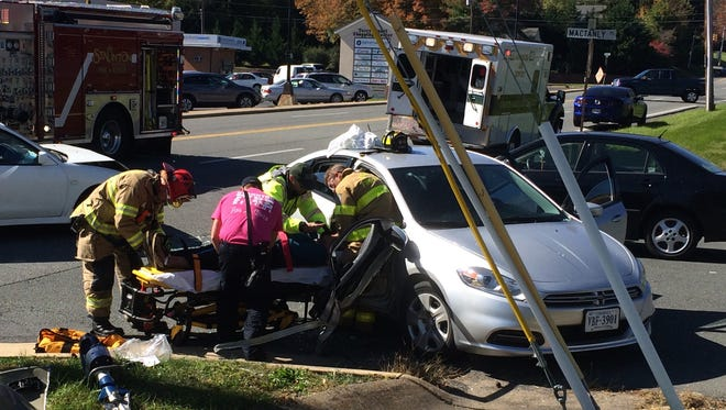An unidentified woman is placed atop a stretcher Friday morning following a wreck in Staunton.