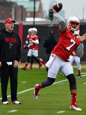 Quarterback Reggie Bonnafon, right, runs through drills while head coach Bobby Petrino looks on during the University of Louisville's first spring football practice on the practice fields aside Papa John's Cardinal Stadium.Tuesday March 24, 2015.(Photo: William DeShazer, Special to The C-J)during the University of Louisville's first spring football practice on the practice fields aside Papa John's Cardinal Stadium.Tuesday March 24, 2015.(Photo: William DeShazer, Special to The C-J)