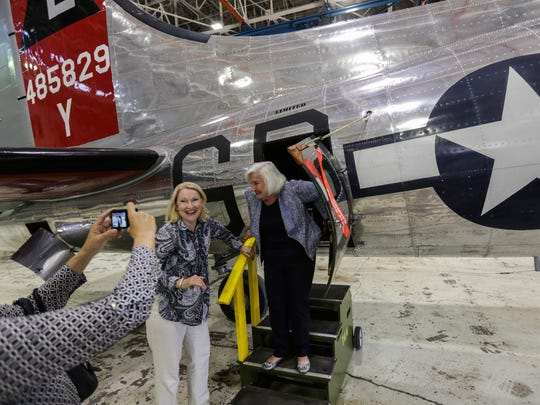 Phyllis Roullier, 97, of Belleville, gets a photo taken with her daughter Jackie Roullier after getting a look inside a B17 plane after receiving an award honoring her as an original 'Rosie the Riveters' by Congresswoman Debbie Dingell at Yankee Air Museum in Belleville on Monday August 1, 2016.