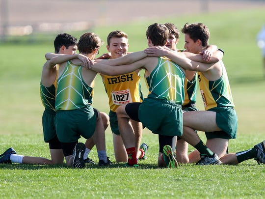 Members of the York Catholic boys cross country team huddle up prior to competing in the boys 1A PIAA District 3 Cross Country Championships held Saturday at Big Spring High School in Newville, PA.