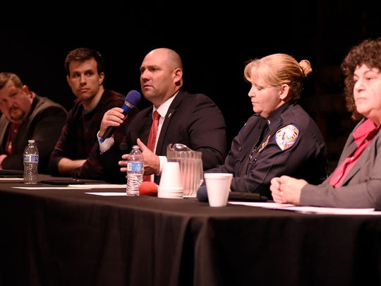 Sheriff's Sgt. Bobby Rader, center speaks during a panel discussion about marijuana as Wes Hardin of Valley Pure, left, Michael Dunaway of Green Bean Pharm, Visalia Police Lt. Amy Watkins, and Tulare County Supervisor Amy Shuklian, right, look on Monday, Jan. 8, 2018, at 210 Connect.