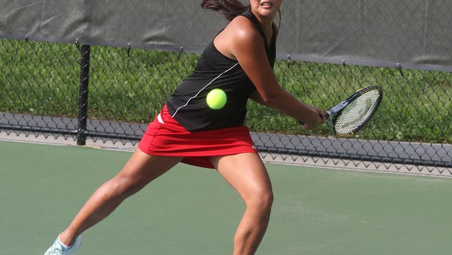 New Philadelphia's Grace Engstrom returns the ball in the tennis match with Alliance Wednesday at Tuscora Park.