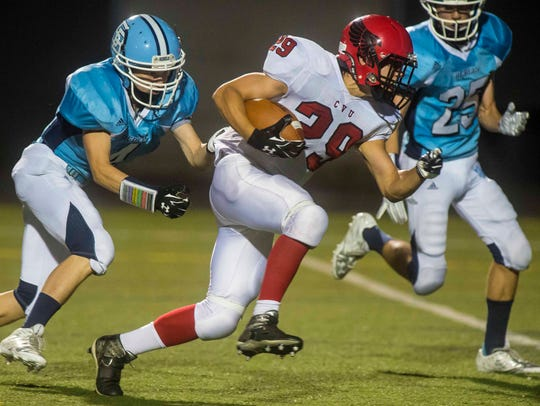 South Burlington's Rye Thayer, left, tries to hold