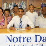 Elmira Notre Dame senior Darius Garvin after signing a Letter of Intent to play basketball at Daemen College. Also pictured, from left, are his stepmom Tammy Garvin, sisters Makayla and Emersyn, brother Evan and his father, John Garvin.
