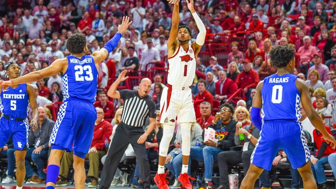 Razorback junior guard Isaiah Joe (1), from Ft. Smith, drains a 3-pointer against Kentucky this past season at Bud Walton Arena in Fayetteville.
