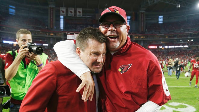 Arizona Cardinals team President Michael Bidwill (left) and coach Bruce Arians celebrate their 17-14 victory against the Kansas City Chiefs in NFL action at University of Phoenix Stadium in Glendaleon December 7, 2014.