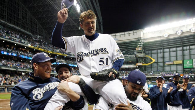 Closer Trevor Hoffman is carried off the field by Brewers teammates on Sept. 7, 2010, after recording the 600th save of his career.