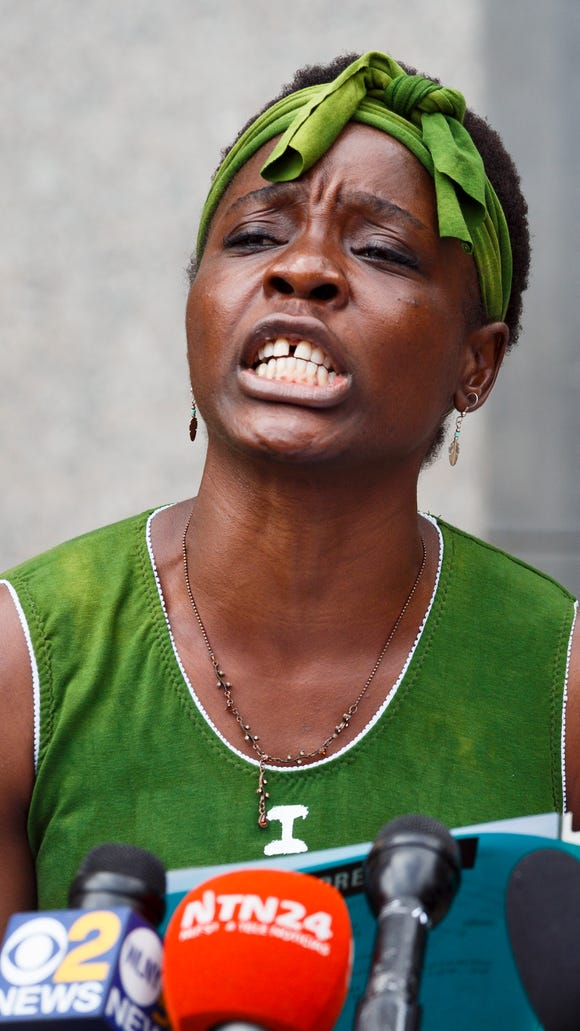 Activist Patricia Okoumou talks to reporters outside of an United States federal courthouse following her hearing, which was related to her arrest on July 4th when she scaled the base of the Statue of Liberty to protest the Trump administration's immigrations policies.