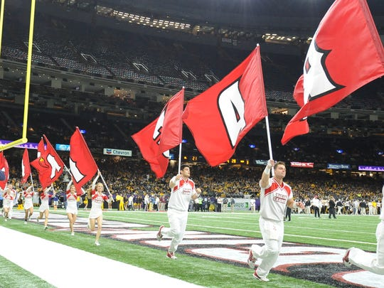 Ragin' Cajuns cheerleaders are shown on the field of the Mercedes-Benz Superdome in New Orleans for the 2016 New Orleans Bowl. The Cajuns have played six games in the Superdome since 2010 and will open their season there Saturday against Mississippi State.