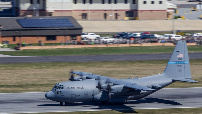 A Delaware Air National Guard C-130 heads down the runway for takeoff at the Delaware Air National Guard Base near New Castle.