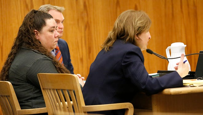 Eve Nance sits between her public defenders Christopher Sobic and Christina Petros last week at her trial. The Fond du Lac resident is accused of the shooting death of her husband in November 2013.