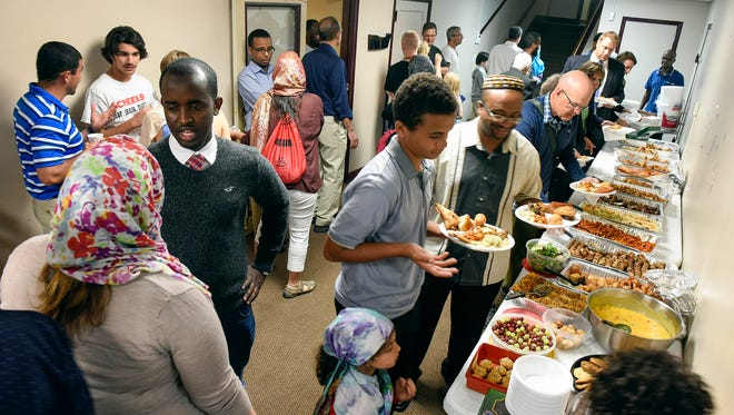Mosque members welcomed community members to join them for iftar, the meal Muslims eat after sunset to break the daily fast Muslims observe during the holy month of Ramadan Thursday, June 23, at the Islamic Center in St. Cloud.