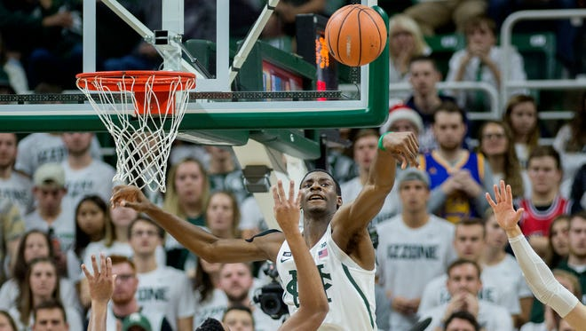 Michigan State's Jaren Jackson Jr., right, blocks a shot by Notre Dame's Bonzie Colson during the first half on Thursday, Nov. 30, 2017, at the Breslin Center.