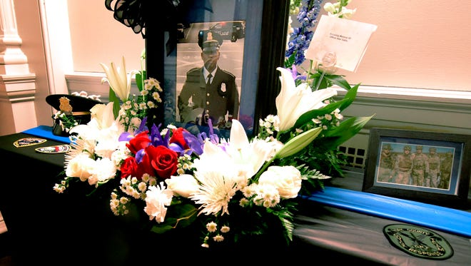 A memorial in honor of York City Police officer Alex Sable pays tribute in the foyer of the York City Police Department Thursday, May 10, 2018. Sable, 37, was participating in a SWAT tactical training exercise in Baltimore County, Maryland, where he suffered cardiac arrest and later died. Bill Kalina photo