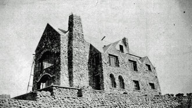 The stone house under construction on Mt. Rose Street in Reno during the 1920s was built by the August Hill family. It still stands today.
