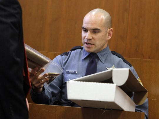 Oregon State Police Senior Trooper Jason Perrizo is seen testifying during a 2013 trial at the Marion County Courthouse in this file photo. Authorities identified Perrizo as the trooper who shot a Grants Pass man following a police chase on Interstate 5.