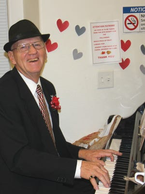 A patron at the Mesquite Senior Center Valentine's dinner started playing romantic tunes.